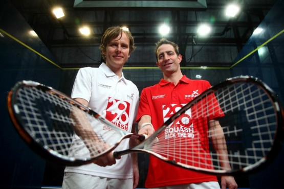 Peter and Tim get in some practice on the glass court at Canary Wharf. Picture by JORDAN MANSFIELD
