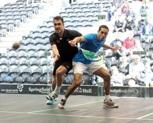 Tarek Momen gets in front of Peter Barker. Picture by STEVE LINE of www.squashpics.com