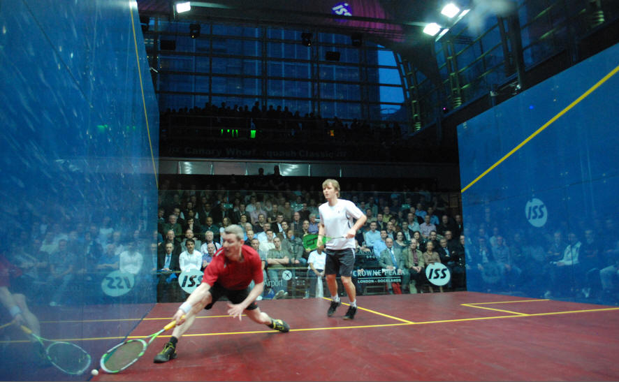 STILL LUNGING! Simon Parke gets forward in a Legends challenge match against Peter Nicol at Canary Wharf