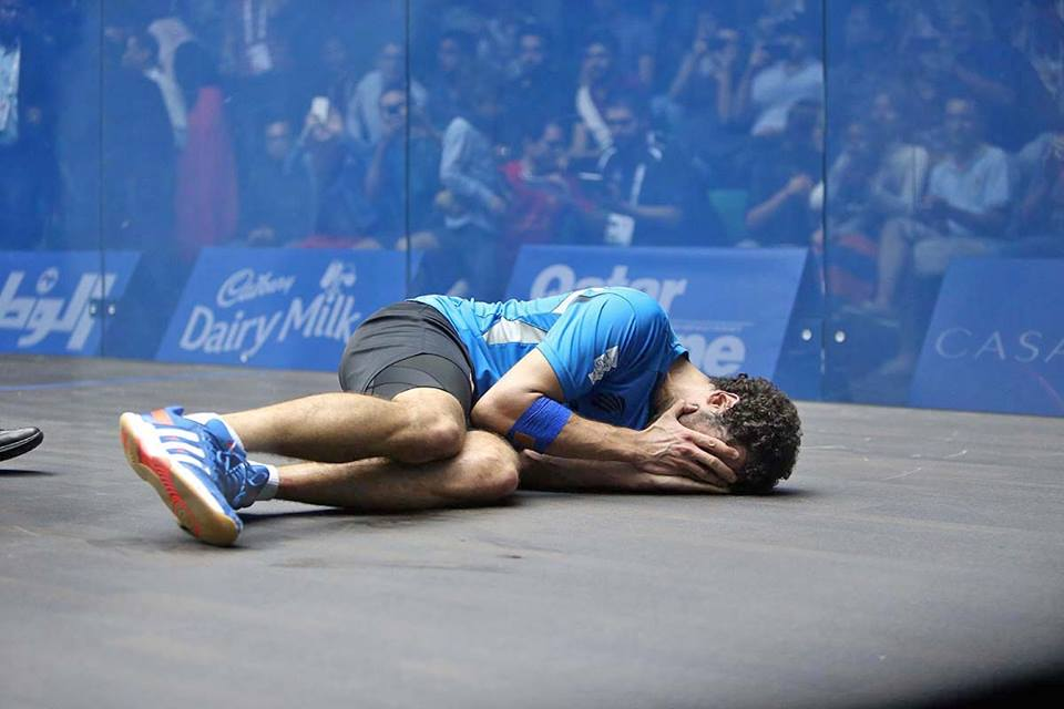 Overwhelmed with emotion, Ramy Ashour sinks to the floor after winning the World Championship final in Qatar