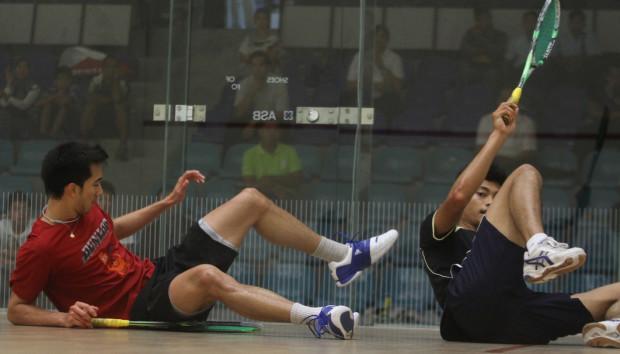 Falling from grace: Asyraf Azan (right) takes a tumble against Kamran Khan