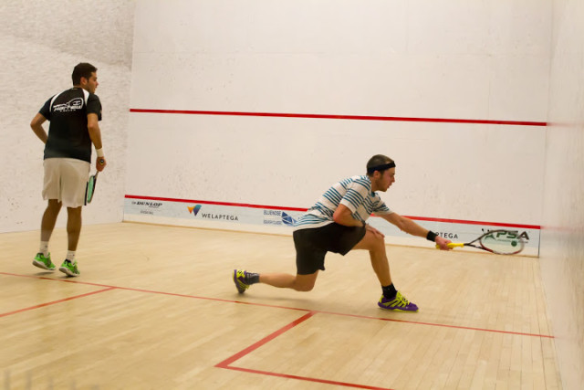 Ryan Cuskelly attacks the forehand front court against Karim Gawad