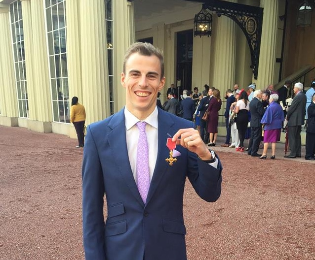 Nick Matthew proudly shows his OBE at Buckingham Palace