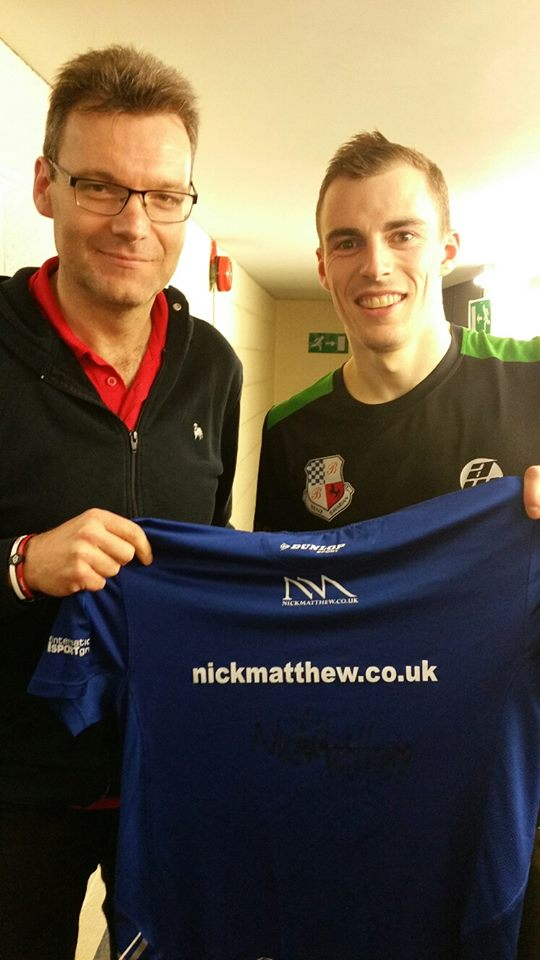 Nick Matthew presents a signed shirt to James Roberts for the World Squash Day Auction