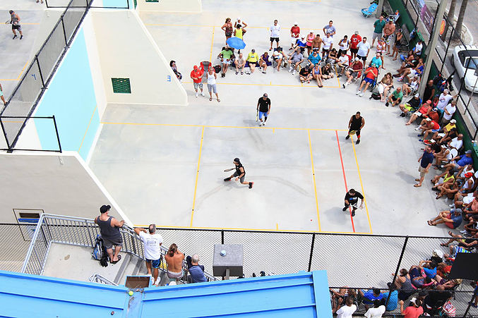 Racquetball played outdoors with just a front wall