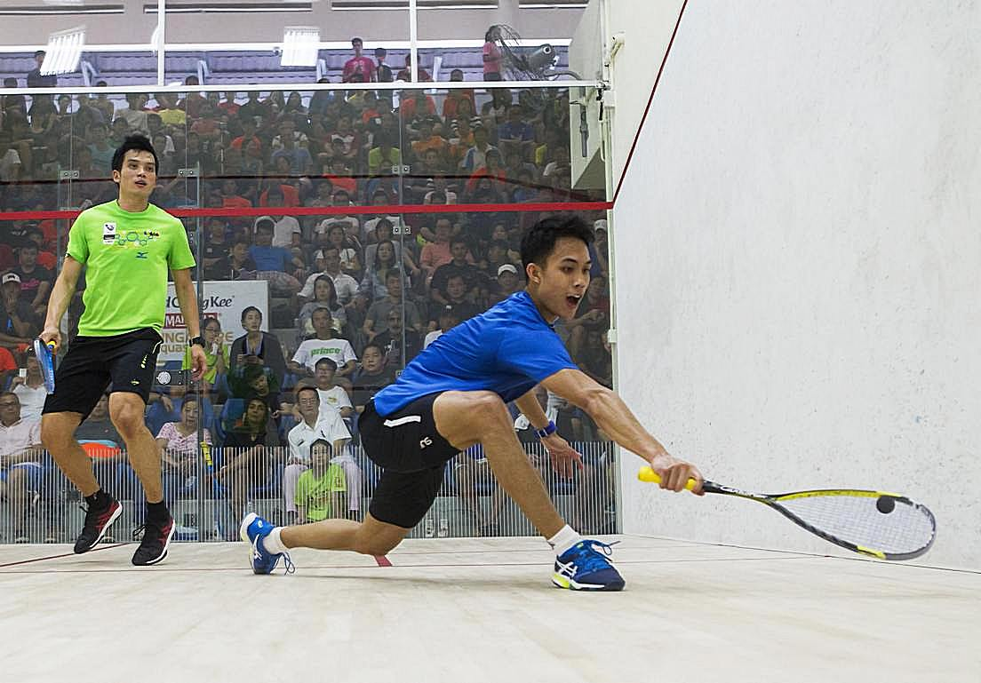 Ivan Yuen (right) proved too much for defending champion Ong Beng Hee