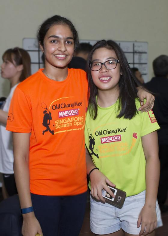 Girls' under-17 champion Sneha Sivakumar (left) with under-19 champion Au Yeong Wai Yhann