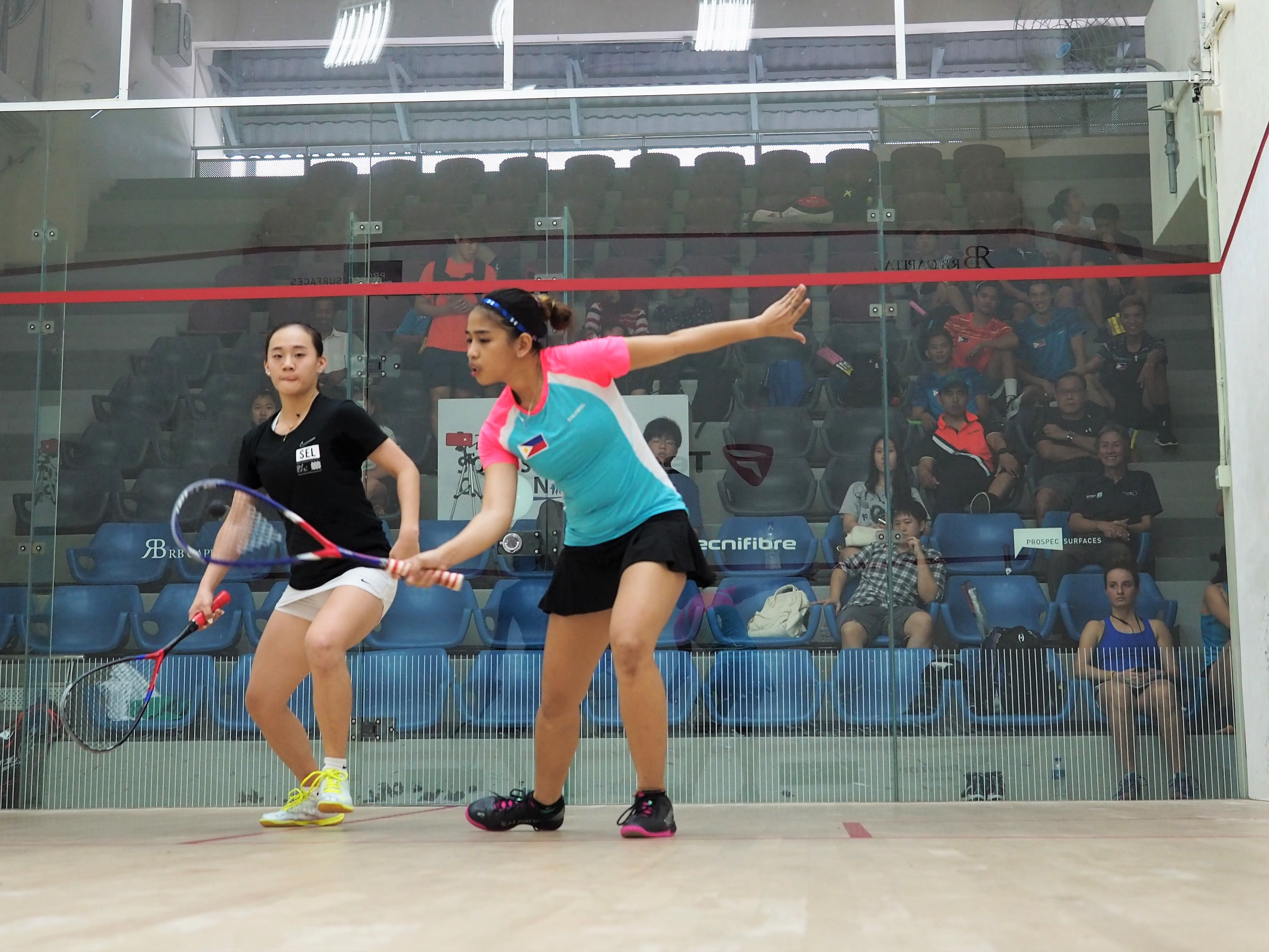 Squash Mad Trio of upsets in Singapore as top seed Wee Wern stays on